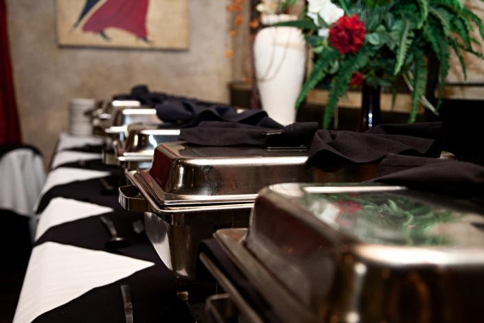 A row of delicious, catered food trays just waiting to be opened by your party or wedding guests.