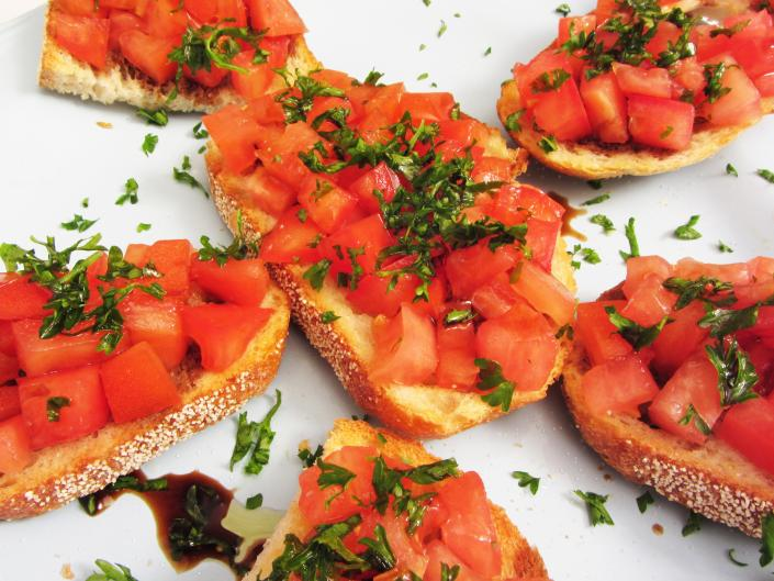 [Image: Our delicious bruschetta will have you definitely wanting seconds of this appetizer. Made with fresh tomatoes and topped with basil.]