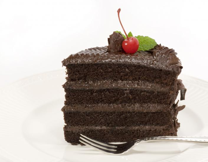 Layered chocolate cake with a cherry on top