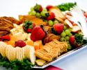 Cheese and cracker platter paired with fresh strawberries and grapes.